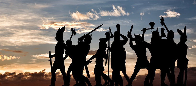 Group of attacking Vikings (silhouettes of vintage toy soldiers) against sunset sky with clouds, Old Norse, Odin, Asgard and Valhalla themes