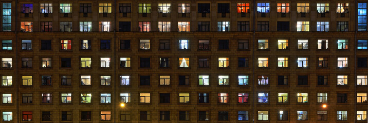 Panorama of the night Windows of the city apartment building