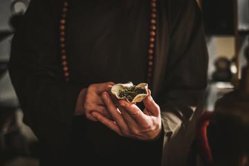 Tea master holding bowl with a tea