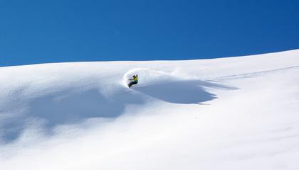 Snowboarder in fine white powder snow Wall mural
