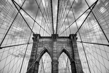 Brooklyn Bridge New York City close up architectural detail in timeless black and white under soft overcast skies