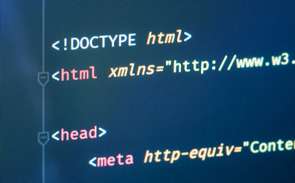 Html document code in text editor close-up on the screen