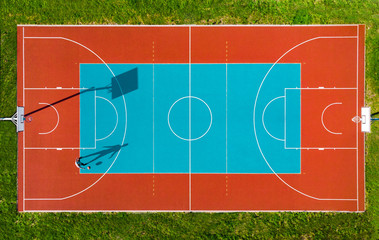 Man Play Basketball on Outdoor Court, Creative Aerial Drone Image