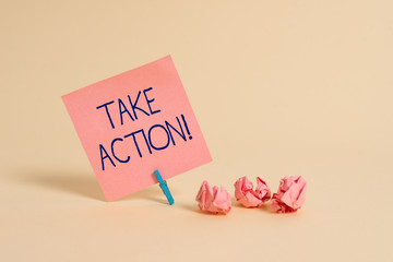 Handwriting text Take Action. Conceptual photo do something official or concerted to achieve aim with problem Plain note paper and stationary placed above soft pastel colour backdrop