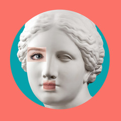 Contemporary art poster with ancient statue of Venus head and details of a living woman's face.