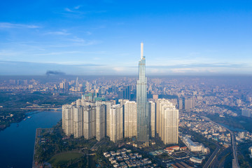 Top View of Building in a City - Aerial view Skyscrapers flying by drone of Ho Chi Mi City with development buildings, transportation, energy power infrastructure. include Landmark 81 building