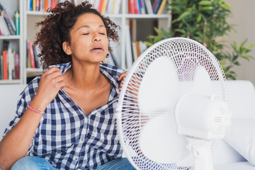 Black woman feeling hot and trying to refresh