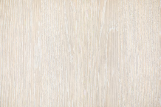 Natural beige wood texture background. Wavy textured plywood, a lot of fiber and small chips, close-up abstract tree background for design, decor and skins