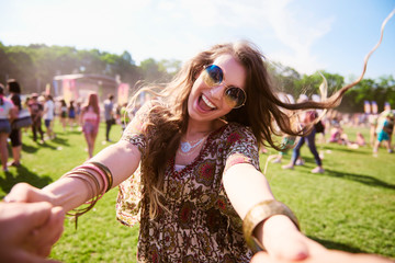Portrait of young boho woman having fun at festival