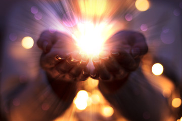 magic particles on the palms of a woman, the flow of magical energy emanating from female hands.