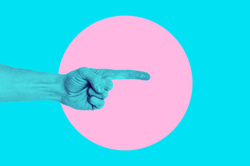 Isolated on blue background painted man hand photo on pink circle. Surrealistic collage style, contemporary art element for design, posters and banners. Cotton candy pop colors. Magazine style