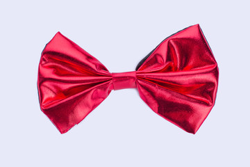 Red shiny bow-tie isolated on white background. Festive satin bow-tie. Beautiful accessory for special event.