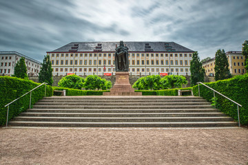 """Monument """"Ernst the pius man"""" in Gotha with Castle Friedenstein."""