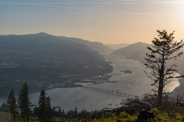 Rare view of the Hood River Bridge connecting Oregon and Washington in the Columbia River Gorge at sunset