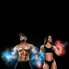 Muscular fitness sports man and fit woman, atletes with dumbbell in fitness gym. Energy and power....