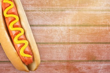 Barbecue Grilled Hot Dog with Yellow Mustard on white background