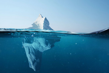 Papiers peints Antarctique Iceberg in the ocean with a view under water. Crystal clear water. Hidden Danger And Global Warming Concept