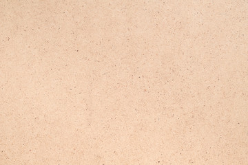 Beige plywood texture abstract art background. Solid color fiberboard surface. Empty space.
