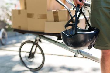Bicycle messenger making a deliveryon a cargo bike Fototapete