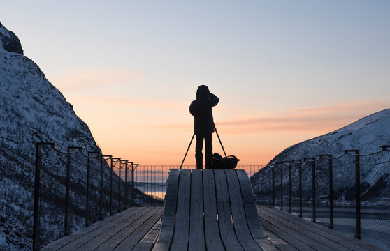 A photographer shooting a fjord in Norway