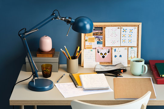 Student's workplace over blue wall.