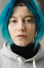 closeup of woman with tattoo on her face