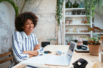 Afro businesswoman working in office.