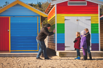 family photos in front of famous bathing boxes