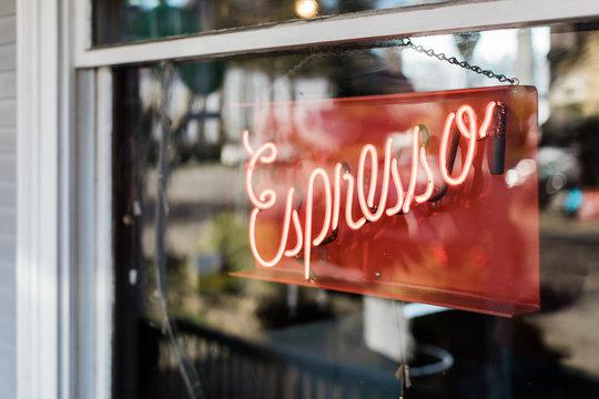 neon sign in window for espresso