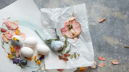 White eggs with dried flowers