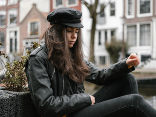 Young woman posing on the street of Amsterdam