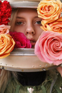Beautiful woman in hazmat suit with flowers