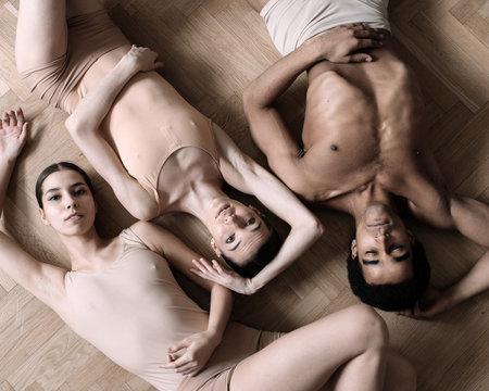 Ballet dancers lying on floor