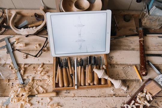 Tablet with blueprint on desk