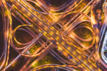 Aerial view of highway at rush hour at night time with car trail and traffic. view from drone Fototapete