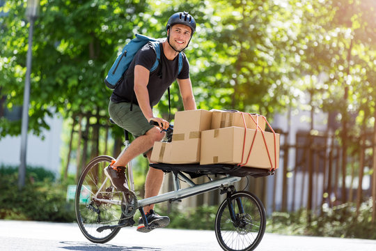Bicycle messenger making a delivery on a cargo bike