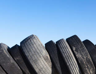 Row of discarded automobile tires in landfill