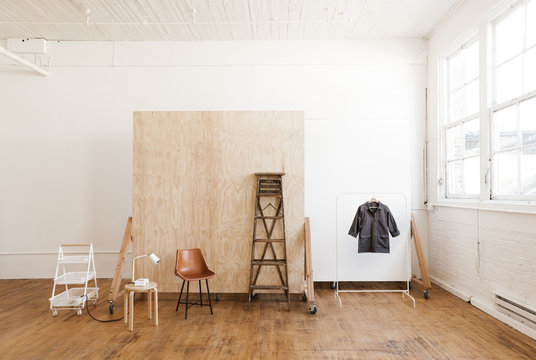 bright white photo studio with props and backdrop walls