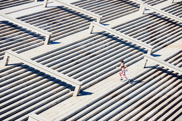 Woman running on concrete steps