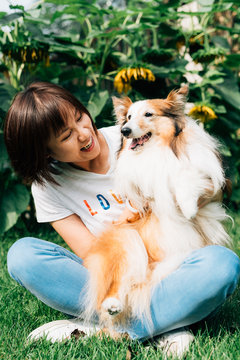 Young woman with her dog at home
