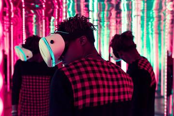 Man in VR glasses in neon lights