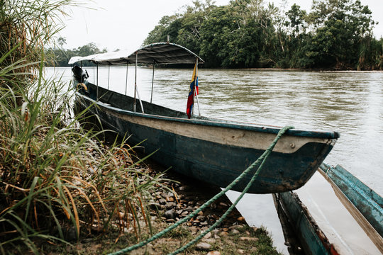 A boat docked on jungle river