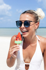 Summer tropic island beach portrait of young happy beautiful woman posing and having fun bear the sea on vacation