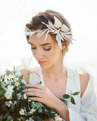 Charming?bride with berry bush twigs