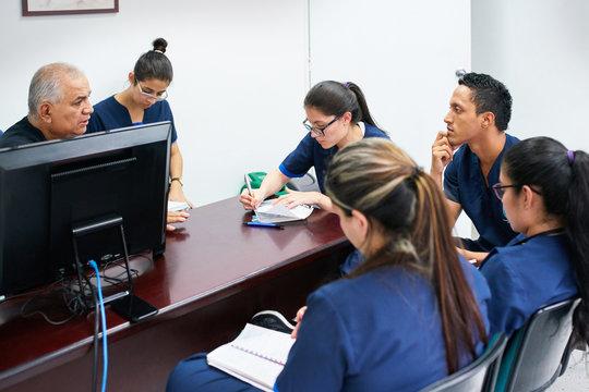 Doctor teaching medicine students
