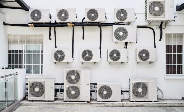 Large amounts of air conditioning units on a wall