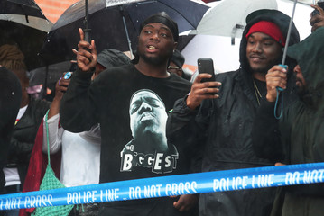 """Fans of the Christopher """"Notorious B.I.G."""" Wallace stand during the opening ceremony of the new Christopher """"Notorious B.I.G"""" Wallace way in the Brooklyn borough of New York"""