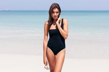 Smiling fashion summer beach portrait of young beautiful woman