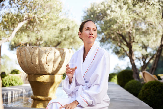 Woman daydreaming at spa having a cup of tea