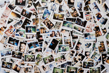 Many polaroid pics scattered on the floor.